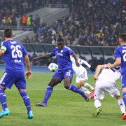 KYIV, UKRAINE - OCTOBER 20, 2015: FC Dynamo Kyiv players (in white) fight for a ball with Chelsea players (Blue) during their UEFA Champions League game at NSC Olimpiyskyi stadium in Kyiv